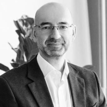 Howden Caninenberg, Versicherungsmakler, Klaus Eisenberger